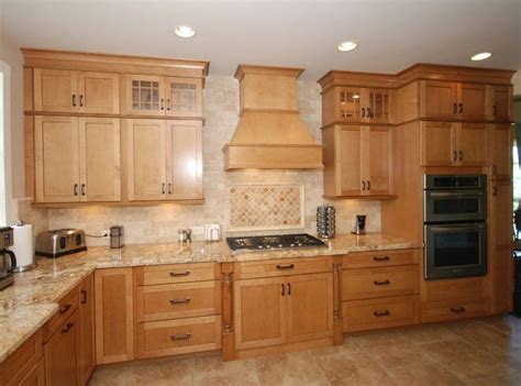 maple kitchen cabinets with granite countertops kraftmaid ginger glaze cabinets with granite countertops