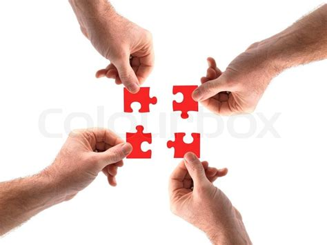 Put Together by Jigsaw Pieces Being Put Together By Stock Photo