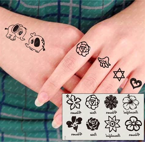 small tattoos for hand collection of 25 small flower