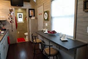 Bar style dining area sits across kitchenette bathroom in rear