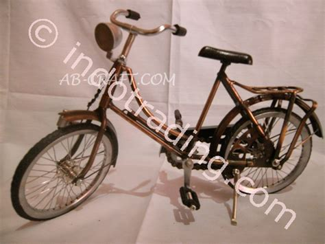 Pajangan Patung Besi Cewek Shopping jual miniature sepeda onthel cewek jogja besi kuningan harga murah sleman oleh pt ab craft