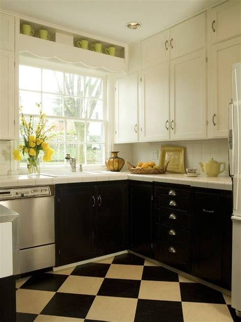 pictures of kitchens with white cabinets and black countertops one color fits most black kitchen cabinets