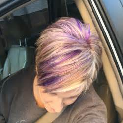lavendar highlights in salt and pepper hair blonde pixie haircut with purple and fuchsia highlights