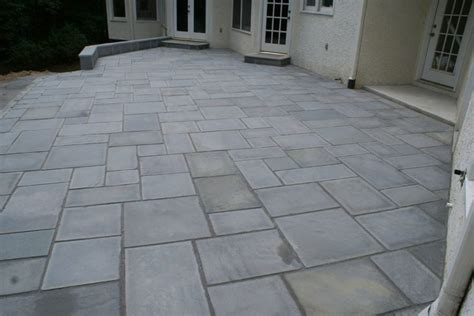 a large formal patio with cut stone in a random pattern