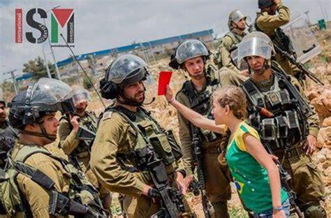 film nabi saleh israel soldiers girl bites hand women rescue tamimi