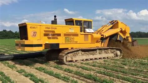 world s largest trencher inter drain 4045 t chain trencher 15 inch install youtube