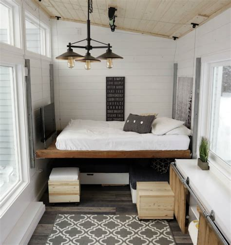 tiny house furniture elevating bed turns tiny house into modern and spacious home