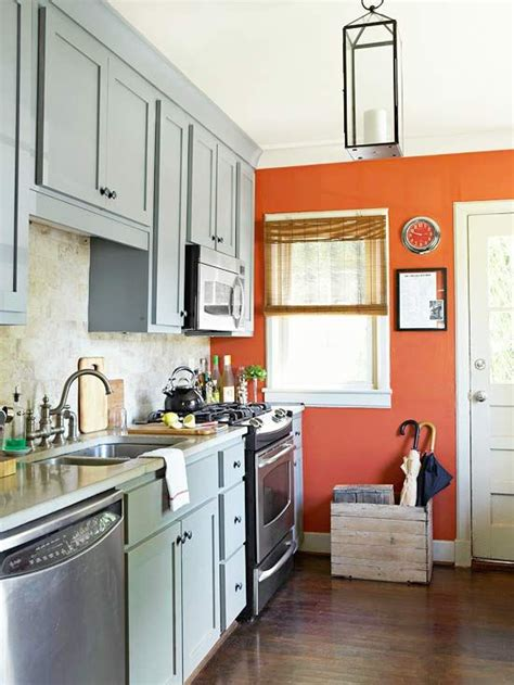 kitchen decorating ideas grey cabinets grey and orange accent walls