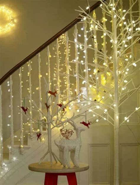 christmas lights wrapped around each stair railing