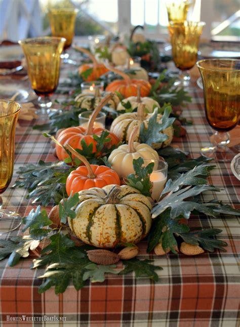 A Thanksgiving Table With Turkey Plates Plaid And Pumpkin