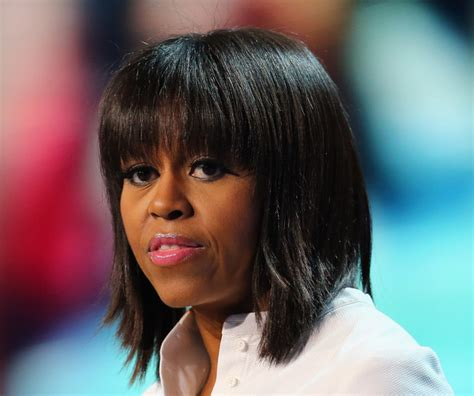 michelle obama haircut michelle obama medium straight cut with bangs michelle