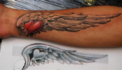 wing tattoo on forearm dmitriy samohin wings mostly