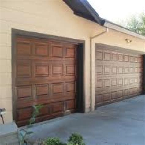 garage door makeover by applying a finishing technique