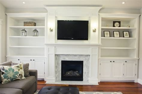 white cabinets around fireplace
