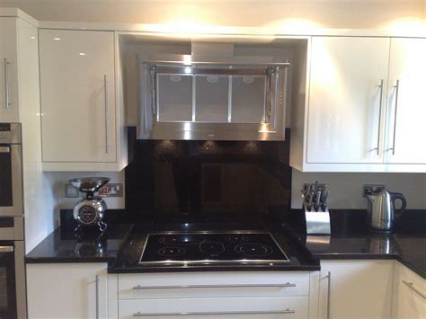 Kitchen With Cream Cabinets by Feature Hob And Extractor