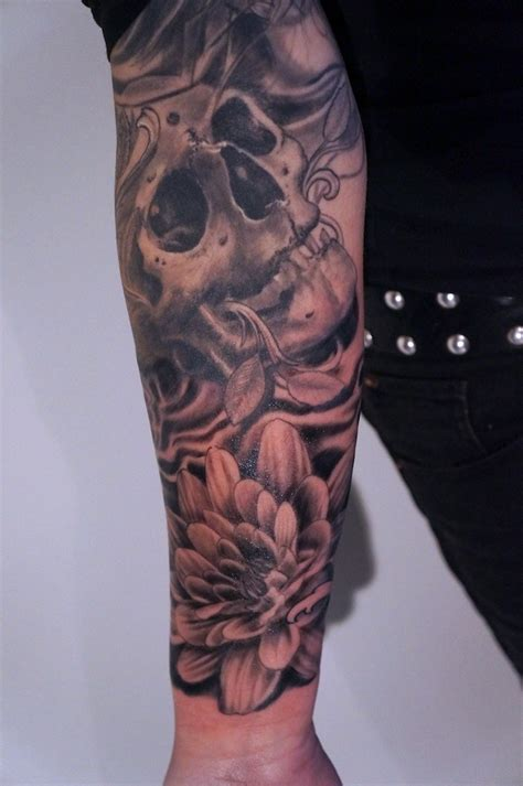 skull and flower sleeve tattoo by graynd tattooimages biz