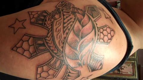 filipino sun tattoo mixed with poly tribal elements