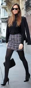 Get this preppy look by pairing your dark blue skirt with a navy knit