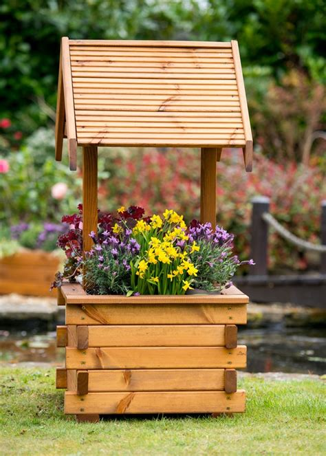 large wooden wishing well planter