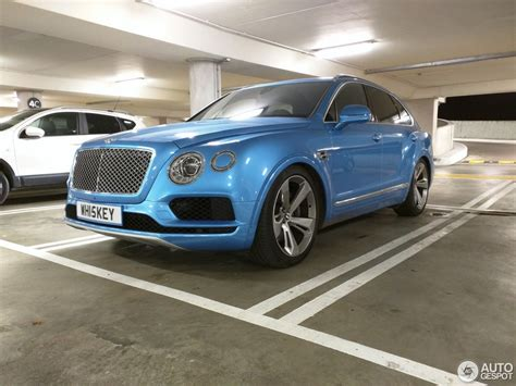 blue bentley royal blue bentley bentayga spotted sitting unusually low