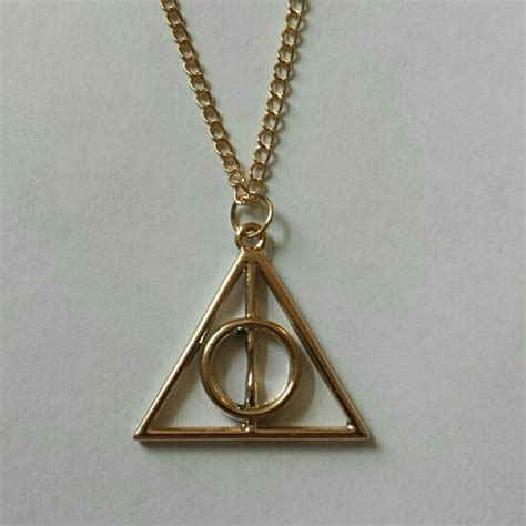 Deathly Hallow Necklaceharry Potterkalungperhiasan 47 jewelry harry potter gold deathly hallows necklace from chelsie s closet on poshmark
