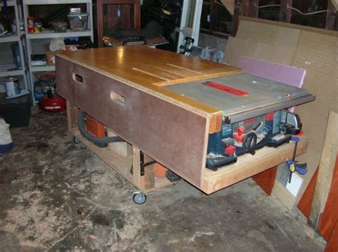 bosch portable table saw bosch table saw stand out feed table finewoodworking