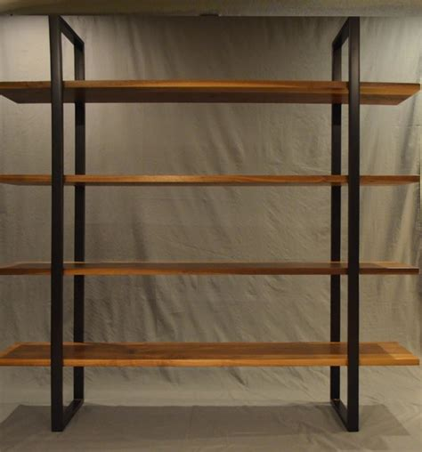 floating walnut and steel bookcase combination with wooden