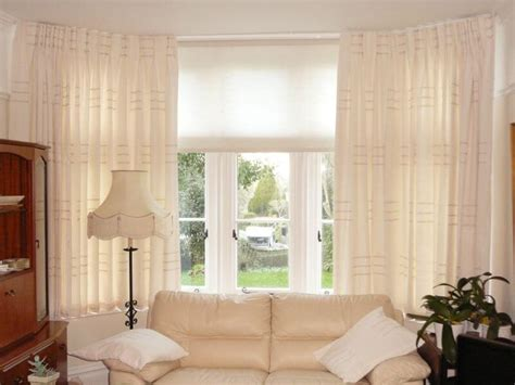 Blinds And Curtains Together Motorized Window Treatments Best Option For Bay Windows