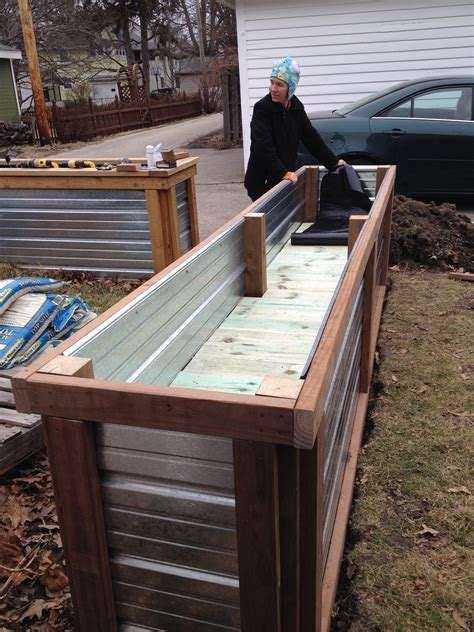 Self Watering Raised Bed by Building A Self Watering Raised Garden Bed Frugal Living