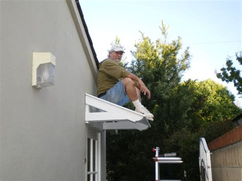 small awnings over doors a small roof for a leaking garage door by bobdurnell lumberjocks com woodworking
