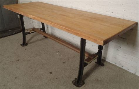 massive butcher block dining table on solid iron legs for