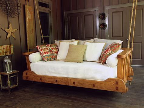 swinging beds who s hooked on hanging daybeds 9 photos the home touches