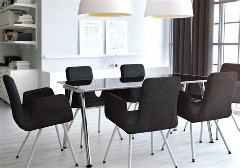 conference room with black visitor s chairs and table in black glass chrome coworking office