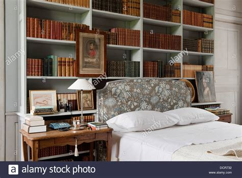 bookshelves as headboard bookshelves above a bed with a marvic fabric headboard