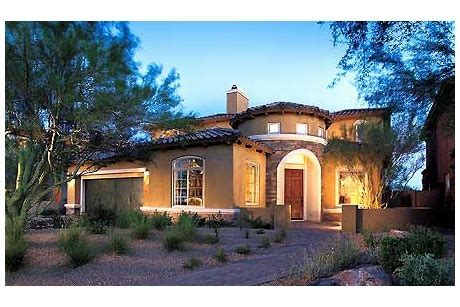 design your own home toll brothers low walls frame an angled entry in this stone and stucco