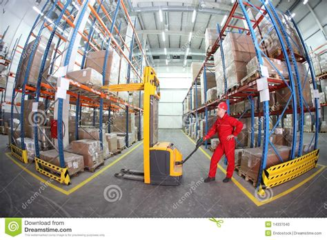 Warehouse Forklift Operator by Warehousing Manual Forklift Operator At Work In Stock Photo Image 14337040