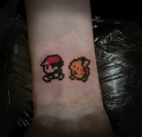 pixel tattoo pixel charmander on right shoulder