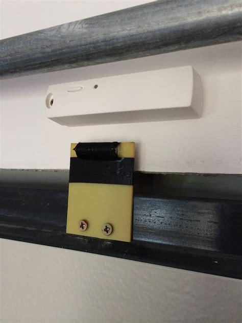 ouverture garage detecteur ouverture diagral sur porte garage sectionnelle
