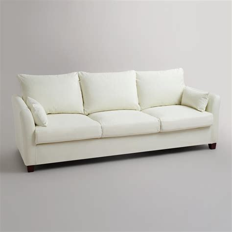 luxe sofa world market ivory luxe three seat sofa canvas slipcover world market