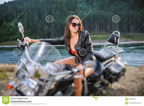 women s short motorcycle young sitting on custom made cruiser motorcycle stock