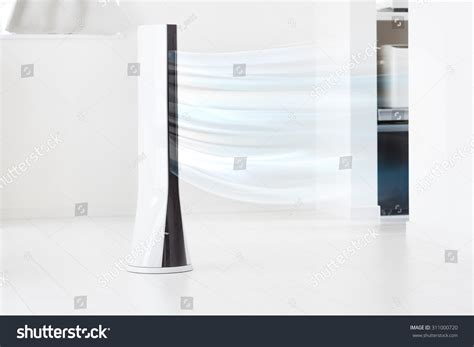fan that blows cold air electronic tower fan blowing cold air stock photo