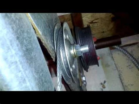 Garage Door Cable Came Pulley by How To Fix A Noisy Garage Door With A Pulley Cable System