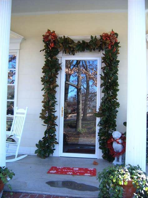 hang garland  front door  vinyl siding
