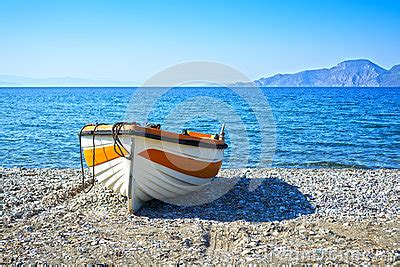 pebble art fishing boat fishing boat stock photo image 58992776