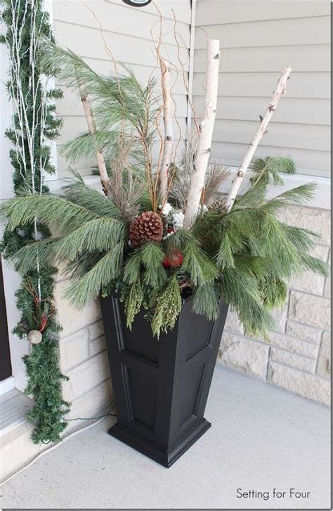 christmas decorating huge stone urns in front of entrance make urns with curb appeal decorate your winter porch with birch branches curly willow large