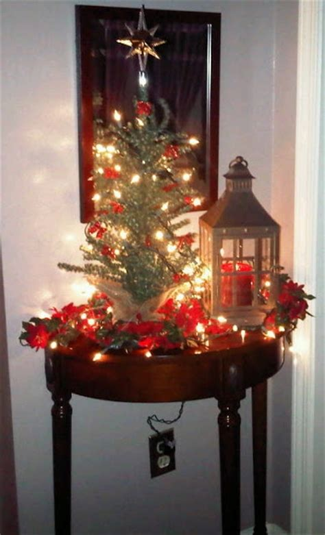 foyer table decorated for christmas