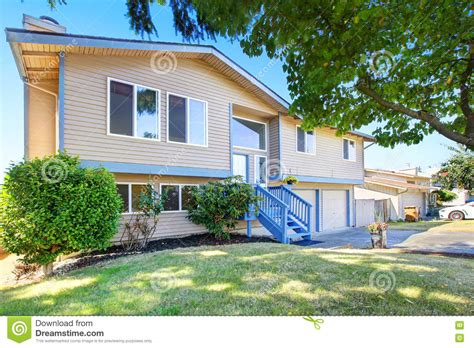 blue siding house exterior of beige siding house with blue trim stock photo