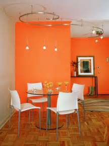 Small dining room decorated in orange color