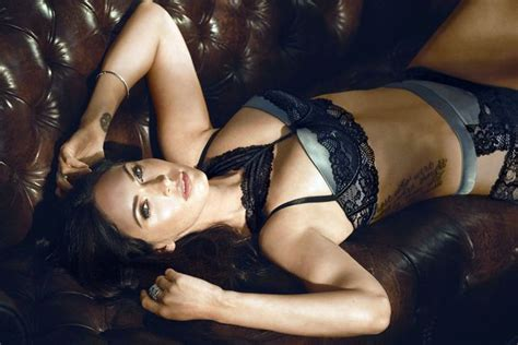 lorena sizzles as she poses on the bed wearing a hot black megan fox sizzles as she poses in sexy and comfortable
