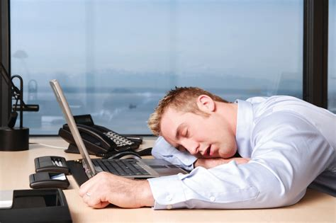 Sleeping On Desk by Many U S Workers Sleeping Less To Work More
